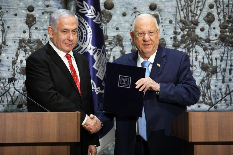 President Reuven Rivlin (R) en premier Benjamin Netanyahu. Beeld EPA