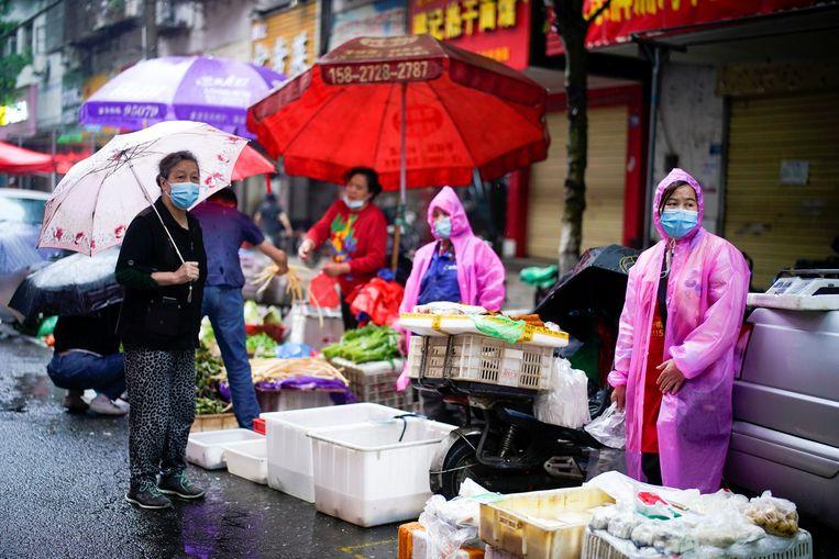 De rol van de markt in Huanan is nooit goed onderzocht, door gebrek aan 'analytische epidemiologische studies', aldus de WHO.  Beeld REUTERS