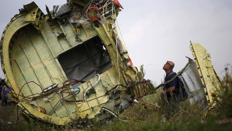 Brokstukken van de Boeing van Malaysia Airlines liggen in het veld van Hrabove, bij Donetsk. De ramp bracht de oorlog in Oekraïne weer volop onder de aandacht. Beeld ©Maxim Zmeyev / REUTERS