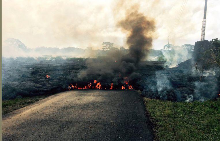 Lava afkomstig uit de vulkaan Kilauea op Hawaï. Beeld AP