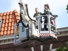 Politie zet hoogwerker in bij inval woning Paul Krugerlaan