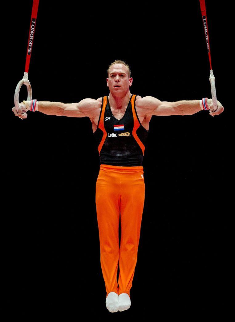 Yuri van Gelder op de ringen tijdens de kwalificaties op het WK turnen. Beeld anp