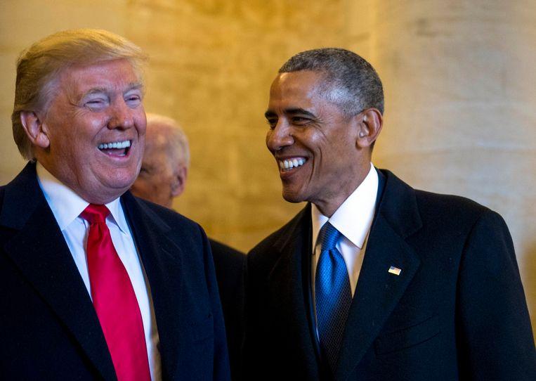 President Obama was er wel bij tijdens de inauguratie van zijn opvolger Trump. Beeld Photo News