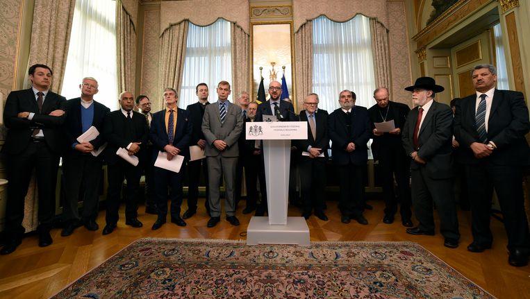 Charles Michel te midden van 's lands religieuze leiders. Beeld BELGA