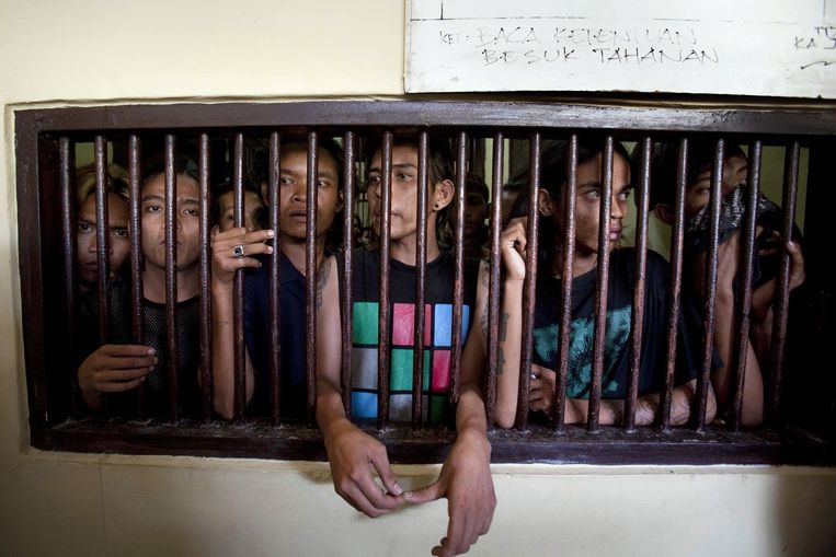 In this photograph taken on December 13, 2011 a group of arrested Indonesian punks are jailed in Bandah Aceh police station in Aceh province. Sharia police are