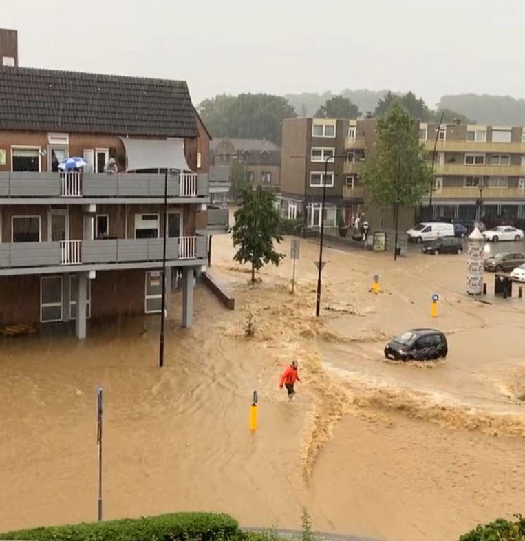 De straat een rivier. Beeld Facebook / pastoor Marc Heemels
