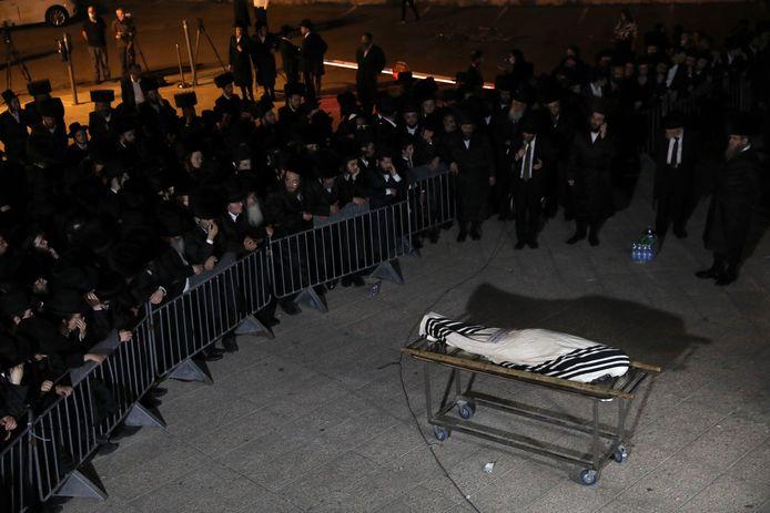 De begrafenis van één van de slachtoffers