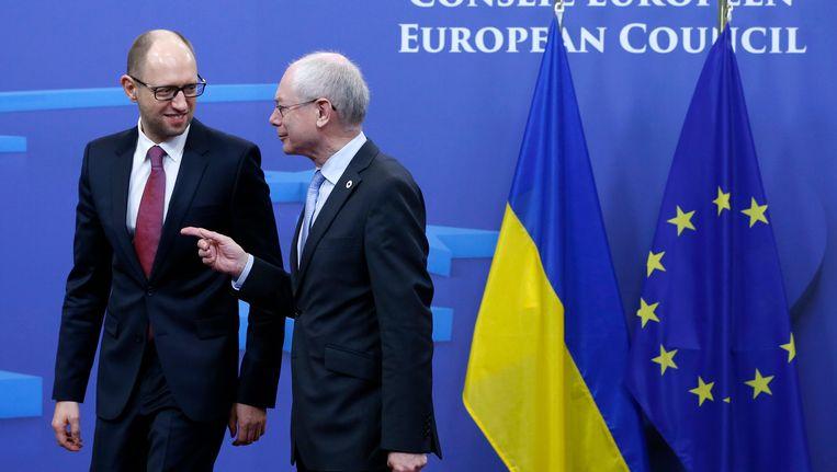 Van Rompuy (rechts) en Jatsenjoek tijdens de EU-top in Brussel in maart van dit jaar. Beeld REUTERS