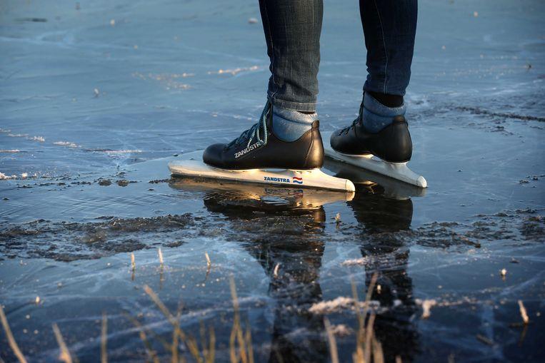 Schaatsers op het ijs in de Rypsjerksterpolder. Beeld ANP