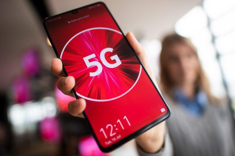 5G wordt de nieuwe standaard in mobiele technologie. Beeld Federico Gambarini/dpa