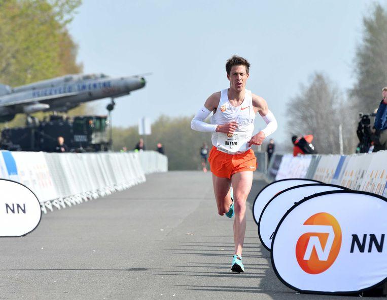 Michel Butter tijdens de NN Mission Marathon op Twente Airport.  Beeld ANP
