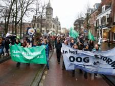 Deze activisten liepen in de stromende regen door de Utrechtse binnenstad voor een beter klimaat