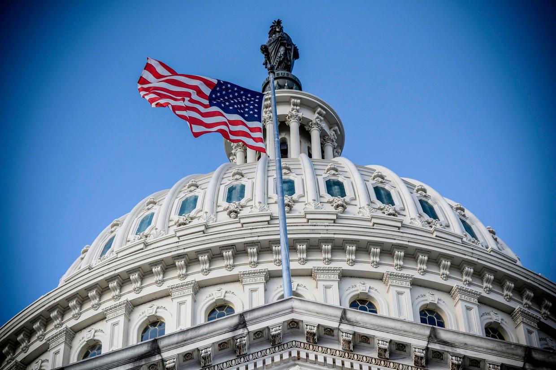 Het Capitool in Washington, de thuisbasis van het Amerikaanse parlement, is deze week het toneel van het laatste felle debat tussen Republikeinen en Democraten over de uitslag van de presidentsverkiezingen. (Foto Eric BARADAT / AFP) Beeld AFP