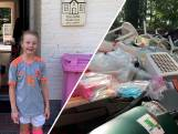 Valerie (8) zamelt plastic afval in, in haar eigen tuin
