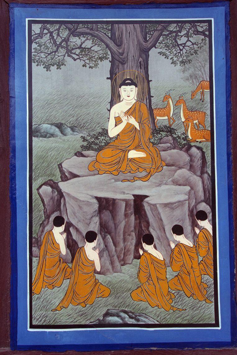 Een tekening van Boeddha en zijn discipelen in de Tripitaka Koreana.  Beeld Sygma via Getty