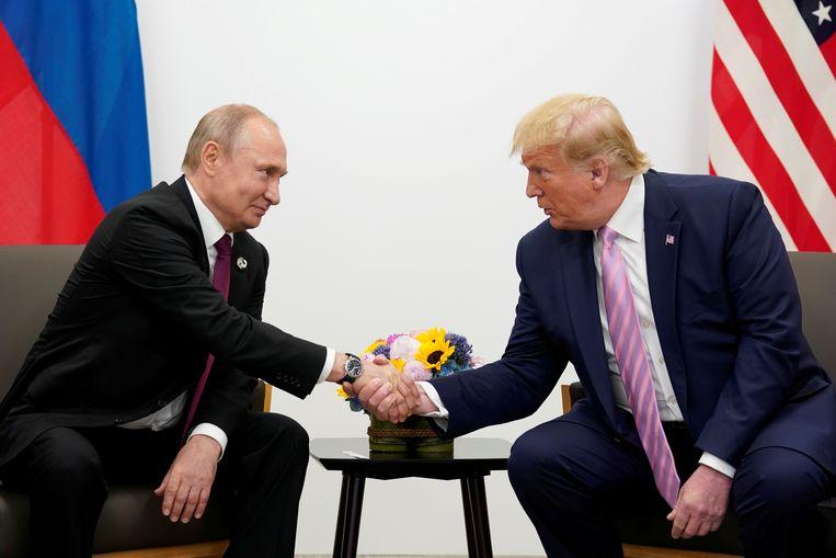 Putin en Trump vorig jaar in Osaka tijdens een top. Beeld REUTERS