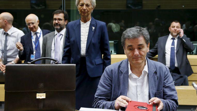 Christine Lagarde en Euclides Tsakalotos. Beeld REUTERS