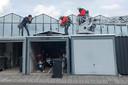 Jeroen Appels tijdens een foto-opdracht van een brandweeroefening met zonnepanelen bij de gemeentewerf in Uden. 30-09-2021
