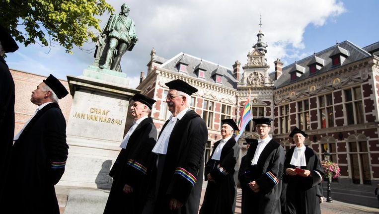Het cortège op weg naar de Domkerk tijdens de opening van het Academisch Jaar van de Universiteit Utrecht. Beeld anp