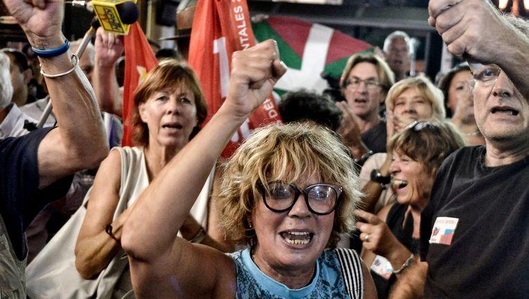 Aanhangers van Syriza juichen als de eerste uitslagen bekend worden. Beeld null