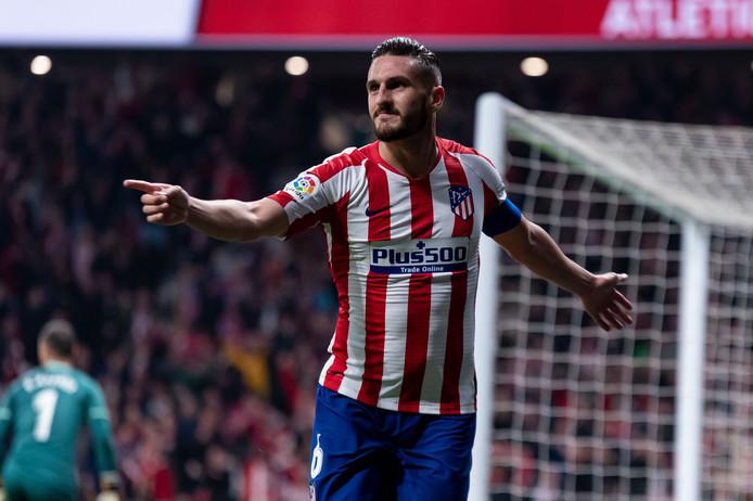 Atlético Madrid-captain Koke juicht nadat hij de 2-1 heeft gemaakt tegen Villarreal.