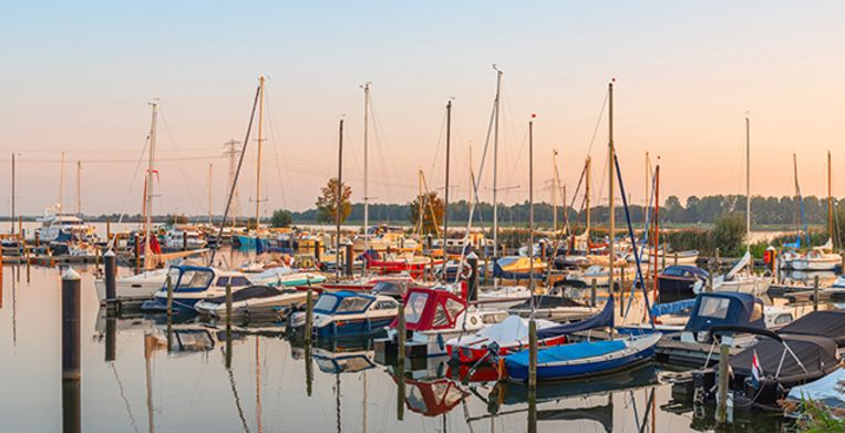 This is a marina with small private boats in the Flevoland province, the Netherlands. Beeld Getty Images