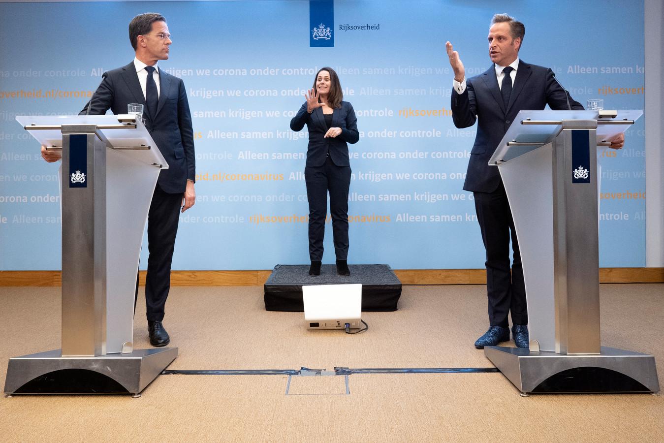 Een van de vorige persconferenties van premier Mark Rutte en minister Hugo de Jonge.
