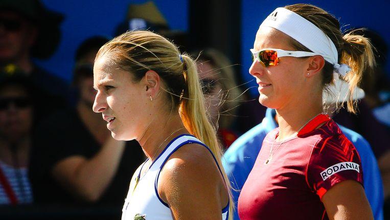 Kirsten Flipkens (rechts) met dubbelpartner Dominika Cibulkova. Beeld BELGA