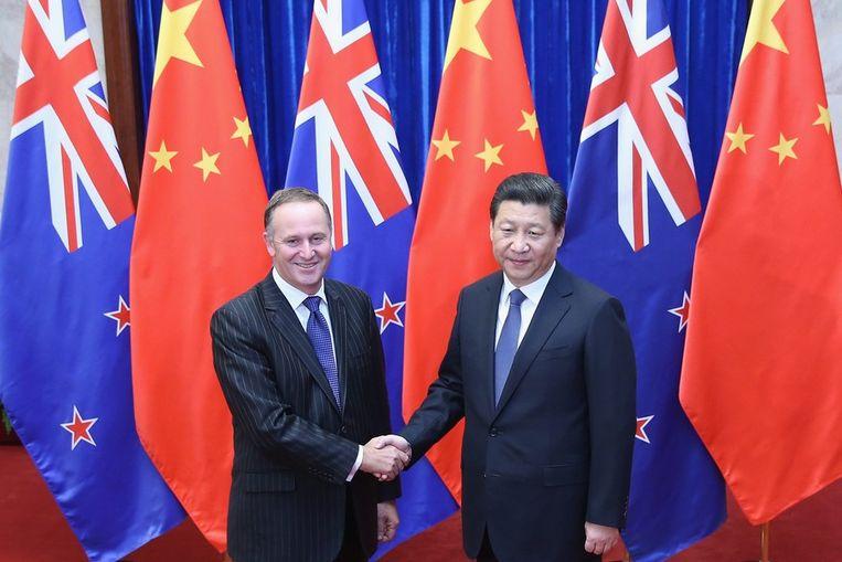 De premier van Nieuw-Zeeland John Key met de Chinese president Xi Jinping. Beeld epa