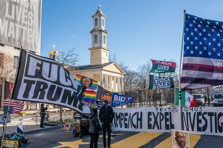 Demonstranten protesteren tegen scheidend president Donald Trump op Black Lives Matter Plaza in Washington, 19 januari 2021. Beeld Getty Images
