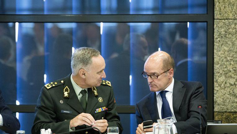 Volgens topambtenaar Wim Geerts (rechts) is IS geen islamitische organisatie, maar een terroristische organisatie Beeld anp