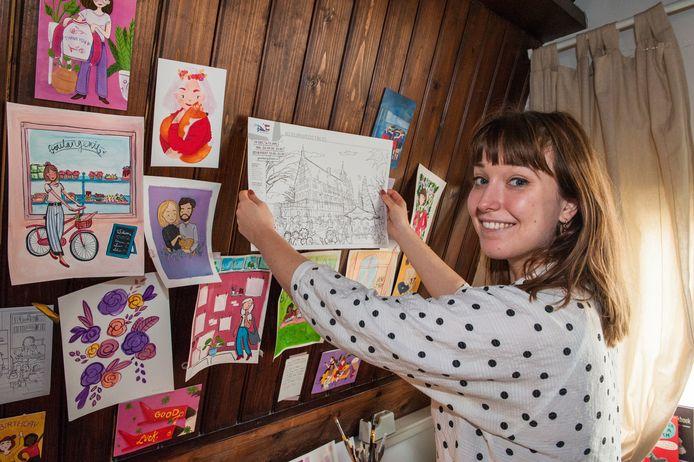 Illustratrice en industrieel ingenieur Anna Lena van Iersel bij haar 'prikbord' met recent eigen werk.