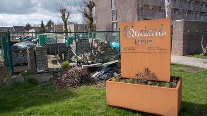 'Bloeiend Melle' naast afvalpark flats