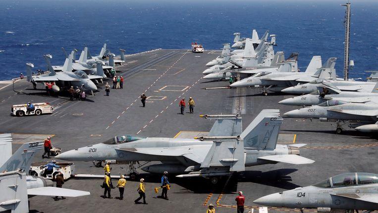 De USS Carl Vinson tijdens een routineoefening in de Zuid-Chinese zee begin maart. Beeld REUTERS