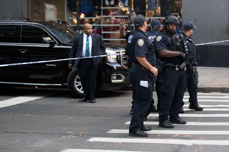 New Yorkse agenten aan een crime scene.  Beeld AFP