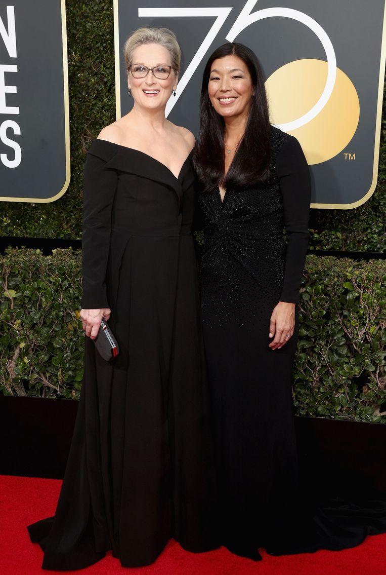 Enkele sterren werden vergezeld door activisten, zoals Meryl Streep, die Ai-jen Poo met zich meebracht, de directrice van de Nationale Alliantie voor Huishoudelijke Werkers die opkomt voor slachtoffers van huiselijk geweld. Beeld AFP