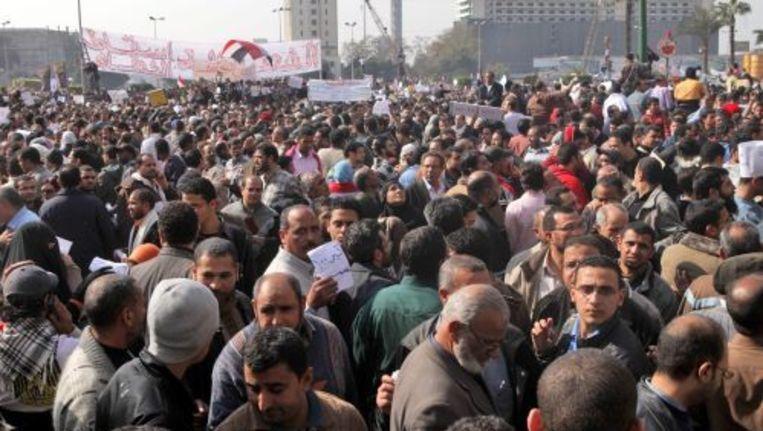 Betogers in Caïro. EPA Beeld
