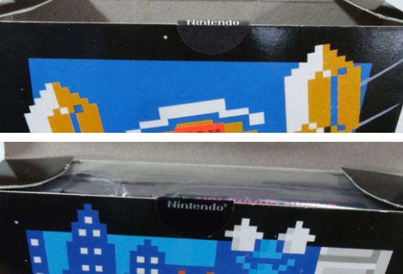 Het zwarte 'NES'-stickertje dat de eerste verpakking afsloot.