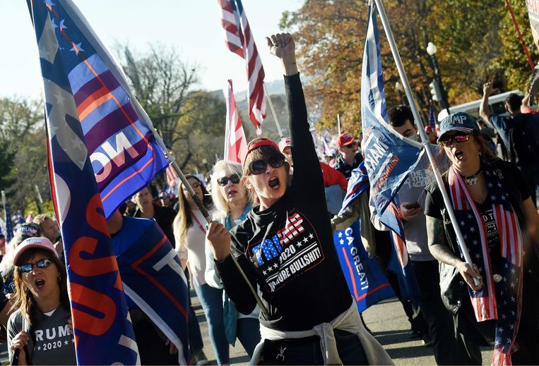 Aanhangers van Donald Trump bij een mars in Washington. Beeld AFP