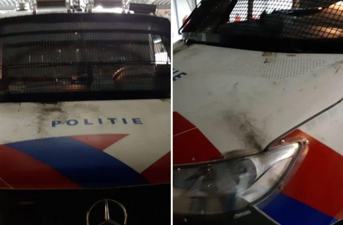 Schade aan een politiebusje.