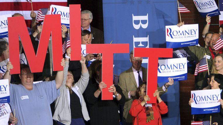 Fans van Romney in de staat New Hampshire wachten op de komst van hun kandidaat. Beeld ap