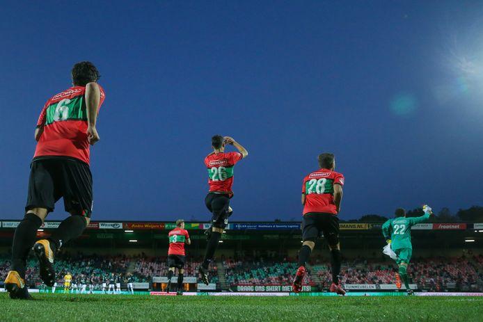 Spelers van NEC komen het veld op voor het duel met Almere City FC, de laatste keer dat er publiek aanwezig was in De Goffert.