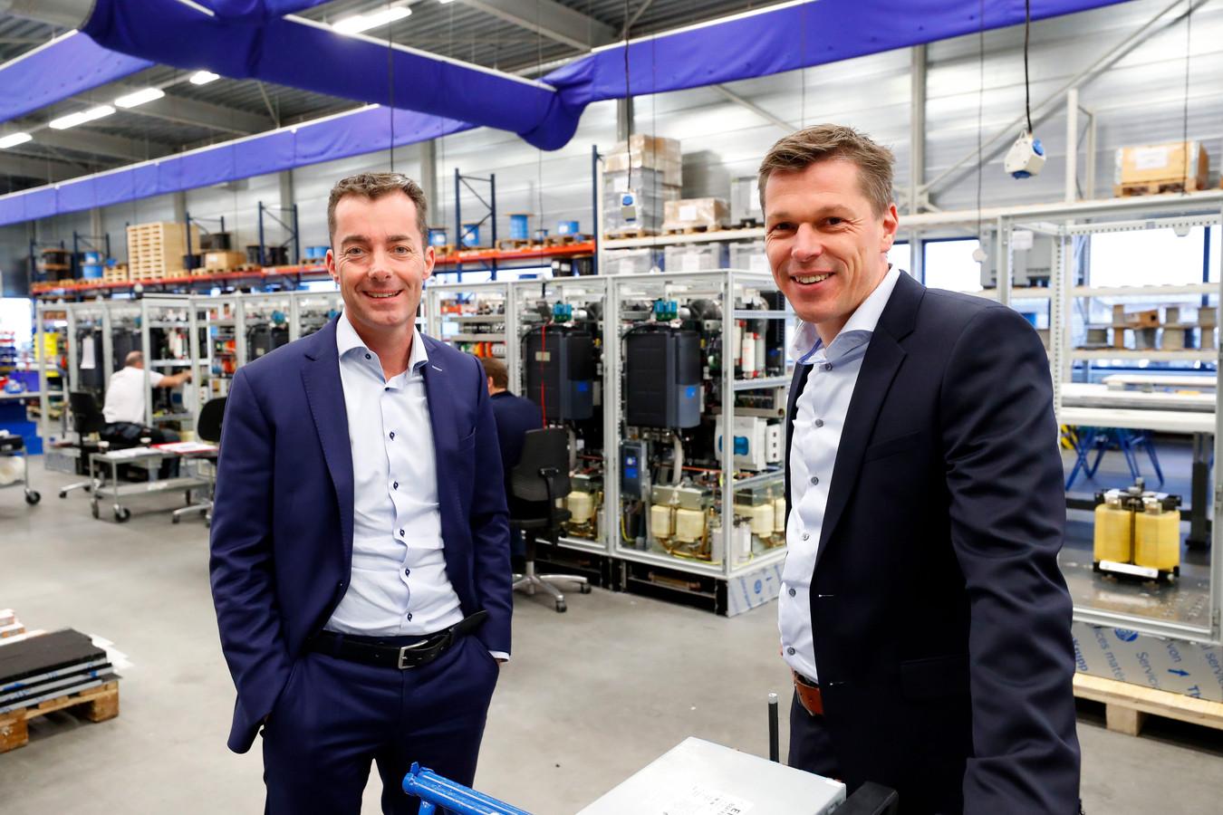 Directieleden Joop Essing (links) en Marc van Happen in de bedrijfsruimte van VHE in Eindhoven.