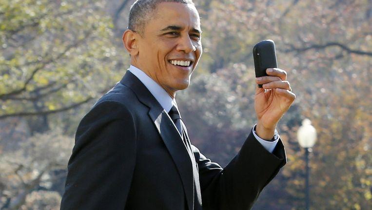 President Barack Obama met zijn Blackberry Beeld afp