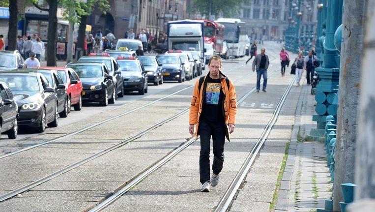 In Amsterdam is de trambaan omgeturnd tot voetpad. Beeld anp