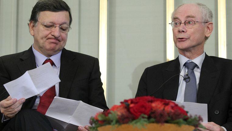 Europees president Herman van Rompuy (rechts) en commissievoorzitter José Manuel Barroso in de Noorse hoofdstad Oslo. Beeld ap
