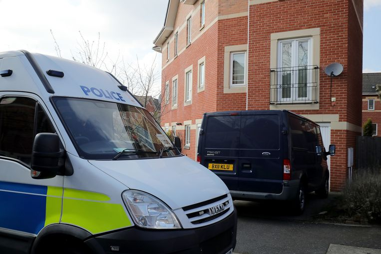 Een politiewagen na een raid in een woning in Quayside, Winson Green, Birmingham.  Beeld Getty Images