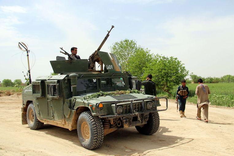 Illustratiefoto. Afghaanse veiligheidstroepen patrouilleren in Helmand, Afghanistan. Door een akkoord tussen de VS en de taliban zou een einde kunnen komen aan een oorlog die al 18 jaar bezig is.