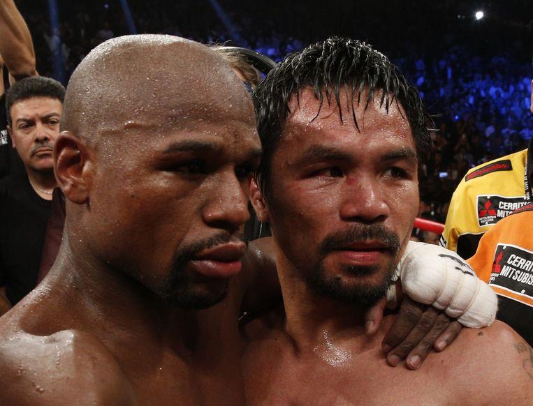 Floyd Mayweather en Manny Pacquiao na de overwinning van Mayweather. Beeld ANP