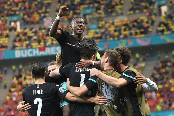 Vreugde bij de spelers van Oostenrijk.